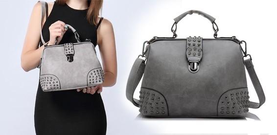 c6b5c4d04ad0 Скидка 55% На женскую кожаную сумку-саквояж с шипами. Удобная форма и  оригинальный дизайн!